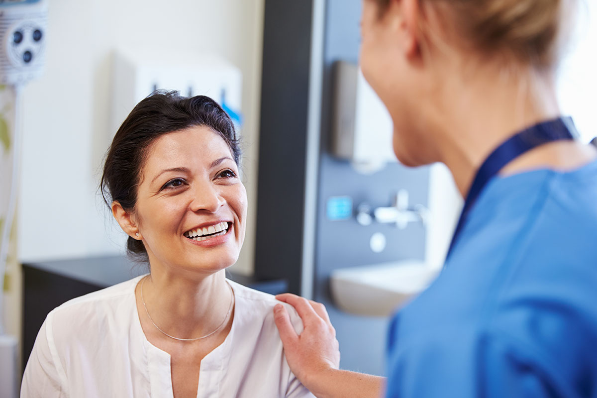 a doctor talking to their patient about benefits of a mat program